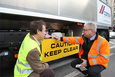 Chris Davies MEP with Carl Milton, Cemex northern logistics manager, looking at proximity sensors and signage on CEMEX vehicle