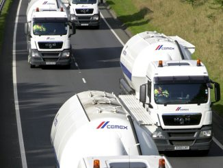 Cemex trucks on road