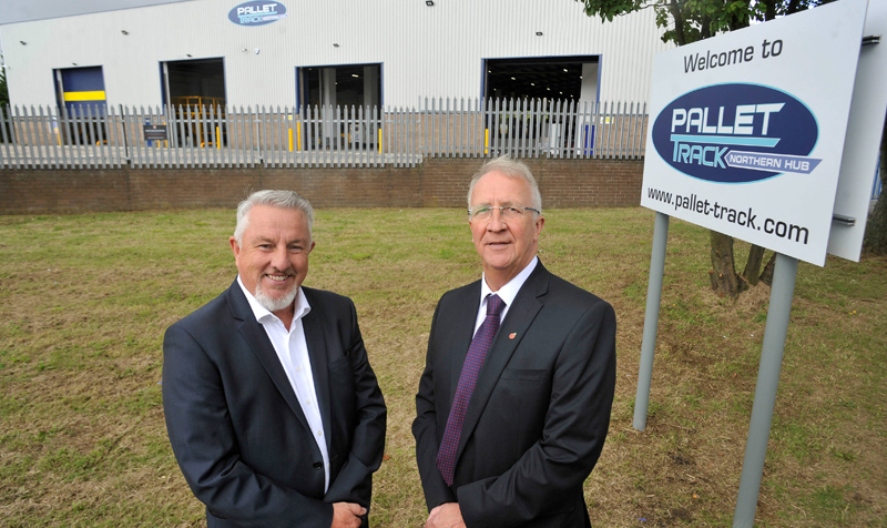 Mark Pulford, logistics director for Pallet-track (left) with Cllr David Molyneux, deputy leader of Wigan Council