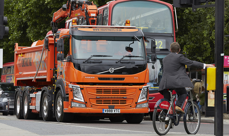 Volvo truck and cyclist