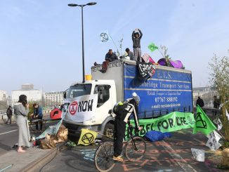 Extinction Rebellion demonstrators on Waterloo Bridge, London, as more than 200 people have been arrested as police deal with ongoing climate change protests.