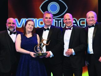 VisionTrack commercial director Richard Lane (far right) presents the trophy to Greenergy Flexigrid CEO Adam Franklin (third left) with host Omid Djalili (far left)