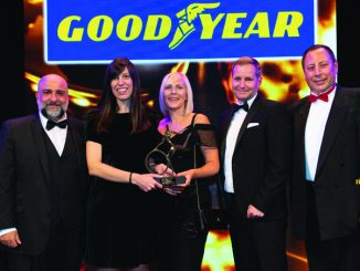 Brigade marketing manager Emily Hardy (centre) and marketing executive Zoe Page (second left) collect the trophy from David Howe, commercial sales general manager at sponsor Goodyear Dunlop Tyres, flanked by comedian Omid Djalili (far left) and MT editor Steve Hobson (far right)