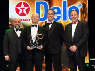 Collecting the trophy for DAF Trucks, MD Robin Easton (second left) with James Welchman, marketing manager EMEA at sponsor Texaco Lubricants (second right), accompanied by comedian Omid Djalili (far left) and MT editor Steve Hobson (far right)
