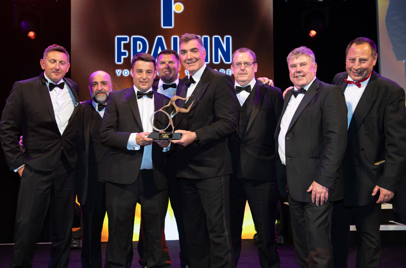 Guernsey Post chief executive Boley Smillie (third left) collects the award from Ed Cowell, CEO of sponsor Fraikin