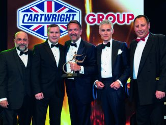MD of sponsor Cartwright Group Mark Cartwright (second right) presents the trophy to DPD UK CEO Dwain McDonald (holding trophy) and chief operations officer Justin Pegg (second left)