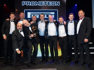 Marco Laraia, marketing manager for Europe at sponsor Prometeon Pirelli Truck (second right), presented the Livery of the Year award to Karl Wilshaw, head of fleet (holding trophy) and the team at Travis Perkins, accompanied by comedian Omid Djalili (squatting) and MT editor Steve Hobson (far right)