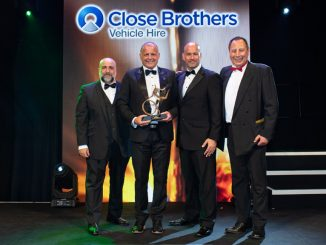 Andy Eccles (holding trophy), head of fleet for Mercedes-Benz Vans UK, accepts the award from Richard Gosling, sales director of sponsor Close Brothers Vehicle Hire (second right), accompanied by comedian Omid Djalili (far left) and MT editor Steve Hobson
