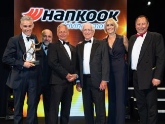 Brett Emerson, UK sales director (third left) of sponsor Hankook Tyre UK, presents the trophy to Cartwright Group MD Mark Cartwright (holding trophy), group chairman Peter Cartwright (centre) and group director Lisa Cartwright, accompanied by comedian Omid Djalili (second left) and MT editor Steve Hobson (far right)