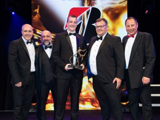Greg Ward, commercial sales director (second right) of sponsor Bridgestone, hands over the trophy to UPS international director of automotive engineering Luke Wake (holding trophy) and automotive director Matt Nicholson (far left)