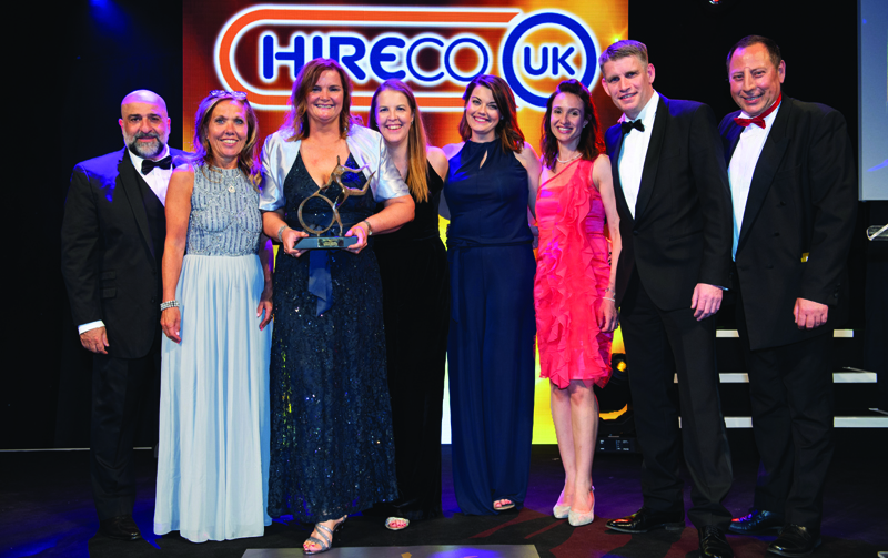 Tim Gibson, sales director (second right) of sponsor Hireco presents the trophy to Lorraine Byrne, HR manager (fourth right), Karen Slack, senior project manager (holding trophy) and the team at Whirlpool UK Appliances