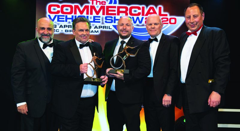 Murray Ellis, director (second right) of sponsor The Commercial Vehicle Show, hands over the trophies to James Hutchison, business unit director (second left) at The Haulage (Holdings) Organisation and Ben Sowersby, MD of Leo Group member Bell Truck and Van