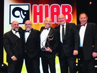 MD David Collett, centre, and projects director Eric Crosby, second left, collect their trophy from Ian Mitchell, MD UK & Ireland, at sponsor Hiab, accompanied by comedian Omid Djalili (far left) and MT editor Steve Hobson
