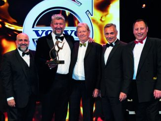 Culina Group CEO Thomas van Mourik (second left) and company secretary Nigel Jury (centre) collect the Haulier of the Year trophy from Robert Grozdanovski, MD of sponsor Volvo Trucks (second right)